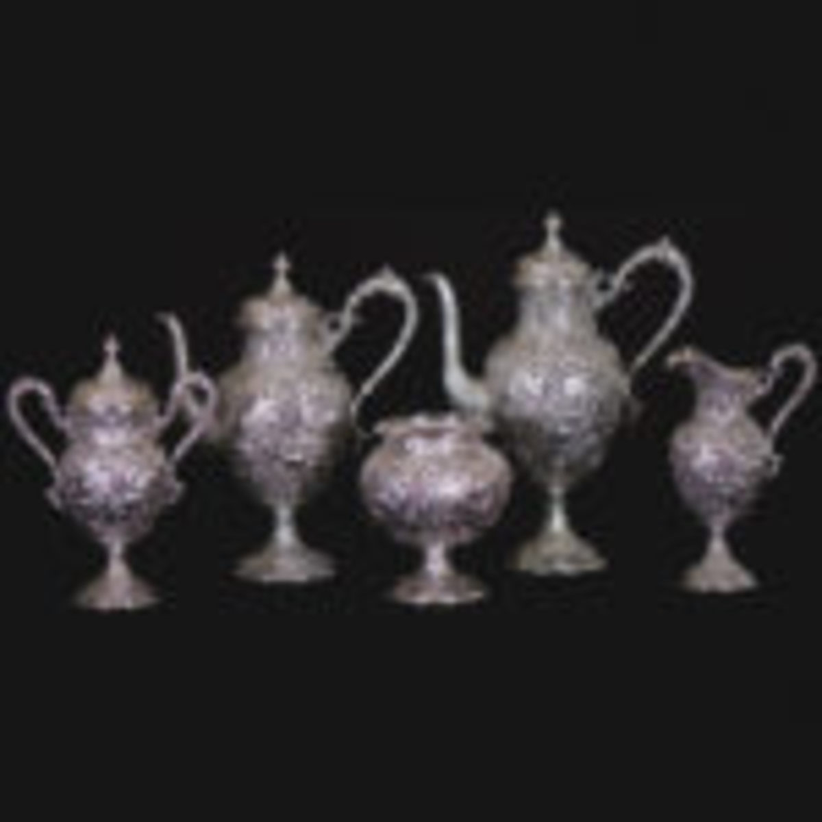 """Seven-piece solid sterling silver tea set, with each piece marked """"The Loring Andrews Company, Cincinnati USA"""", with a total weight of 321 troy ounces ($14,000)"""