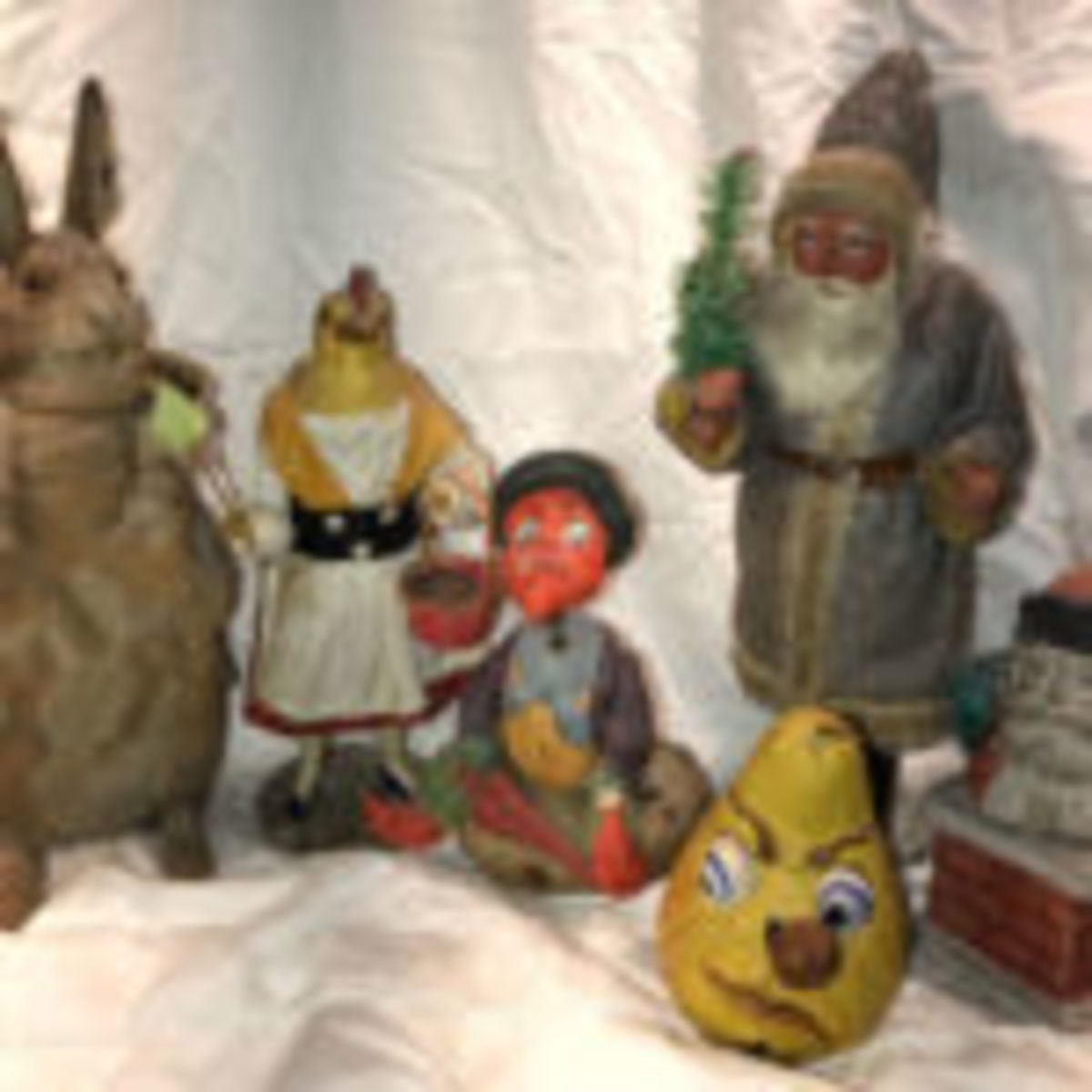 Scott Tagliapietra of Scott's Antiques, Whitefish Bay, WI (well-known holiday, doll and toy dealer) collects antique candy containers, particularly circa 1910 German papier-mâché examples. Here are just of few of the pieces he will share at the special exhibit.