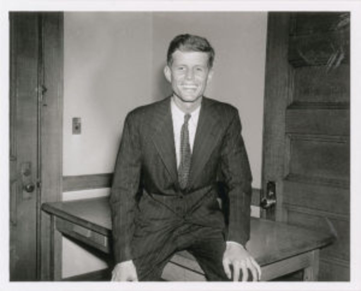 JFK sitting on desk_portrait for senate campaign