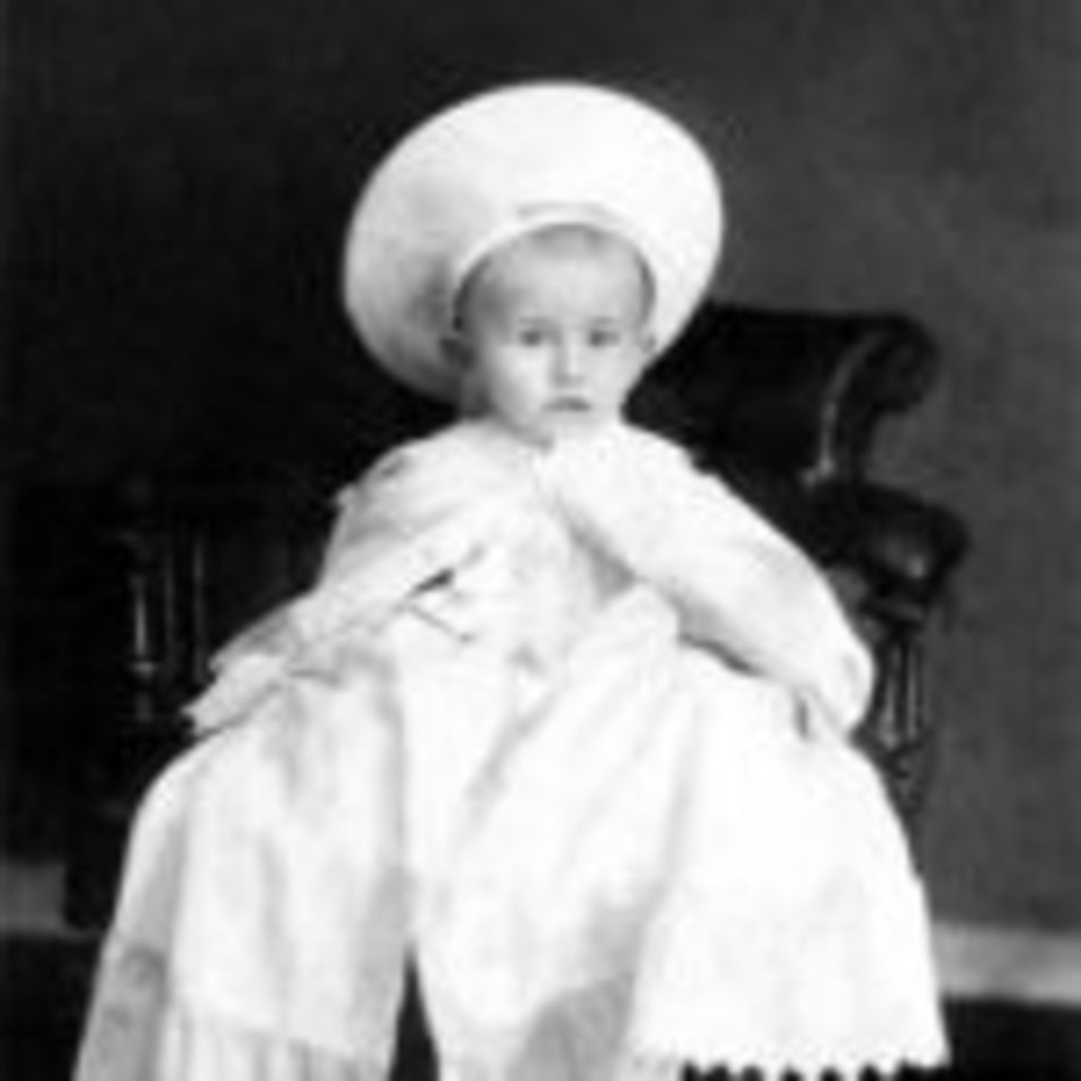 early photograph of unsmiling baby