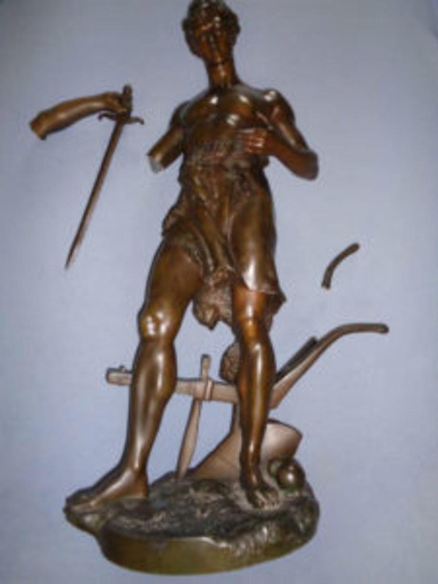 Broken bronze figure
