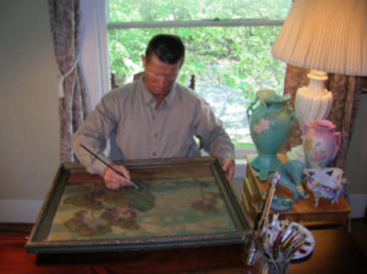 Laszlo restoring a painting