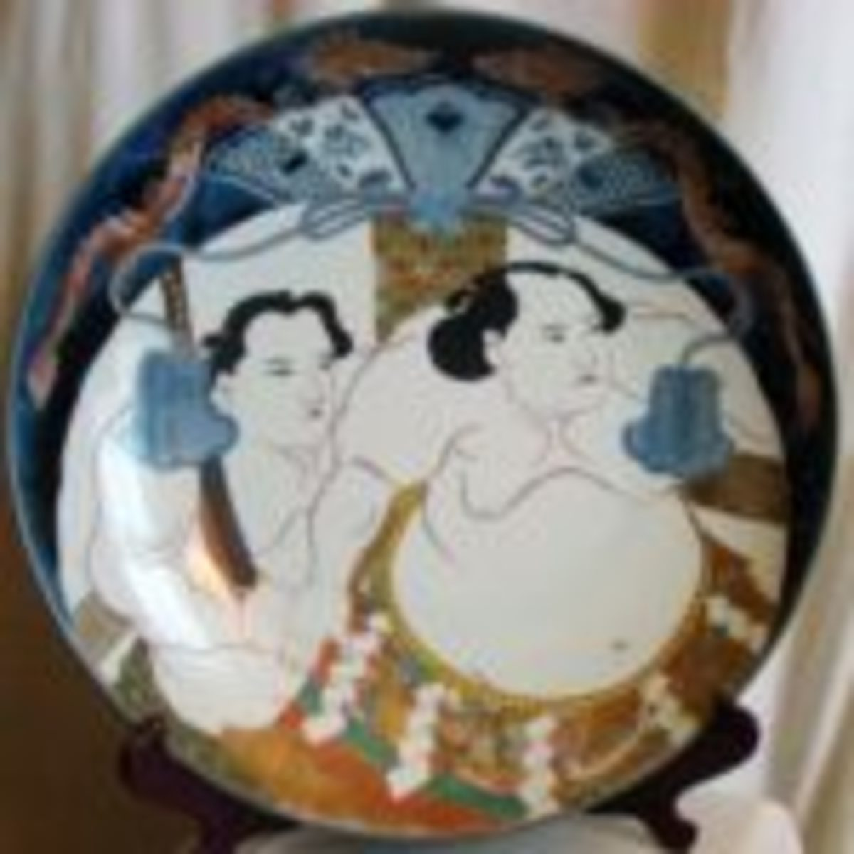Imari charger featuring Sumo wrestlers