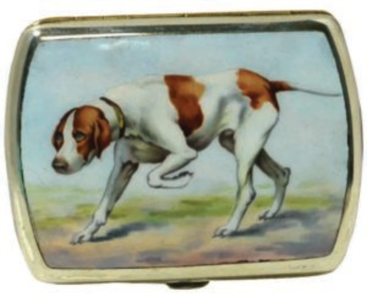 "The classic portrait of the Pointer on this silverplate cigarette case is the ultimate expression of canine grace and power. Done in porcelain enamel, c. 1920, 3-3/4"" l x 2-3/4"" h, gilded on the inside and on the back. Image courtesy of A Dog's Tale Collectibles"