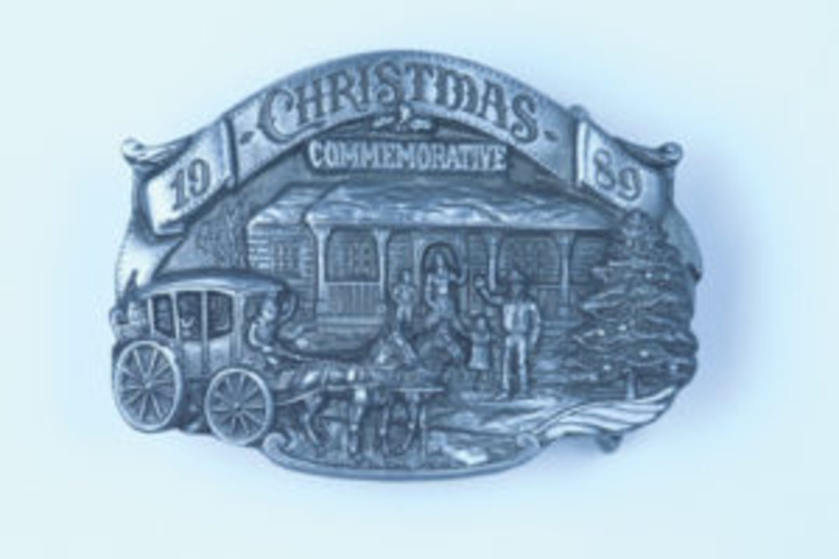 """1989 Christmas Commemorative buckle. Beltside reads: """"This buckle is the seventh in a yearly series, wishing you and your family a very Merry Christmas."""" Stephen F. Curry, Linda West Curry / © 1989 Arroyo Grande Buckle Co. 1989 Limited Edition, No. 102 of 750. ($14.11, April 2017)"""