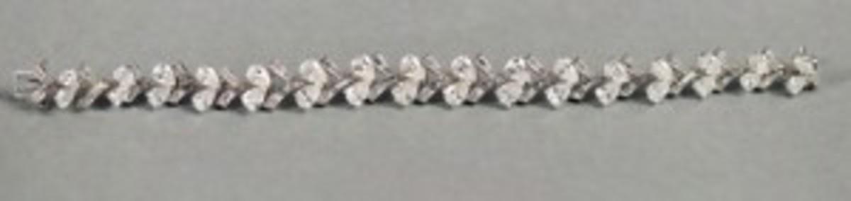 Lady's diamond bracelet, featuring more than 100 diamonds.