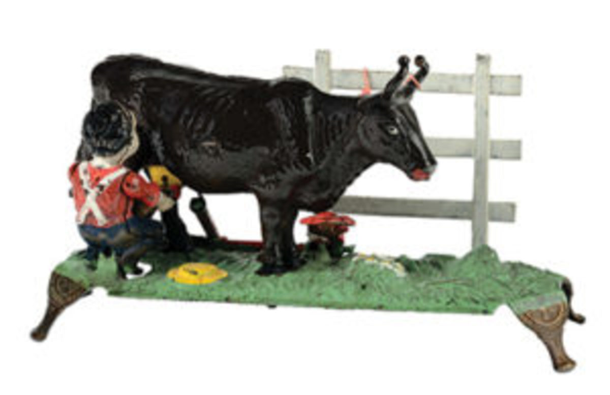 "J. & E. Stevens ""Milking Cow"" cast-iron mechanical bank, thin base variation, provenance: Covert Hegarty collection. sold for $49,200."