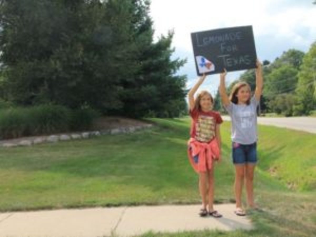 Children in Oak Creek, Wis. holding sign promoting their neighborhood lemonade stand, with proceeds going to the family impacted by Hurricane Harvey. Learn more in an article by the Milwaukee Journal Sentinel: http://bit.ly/2x39HH6 (Tiffany Stoiber/Now News Group)