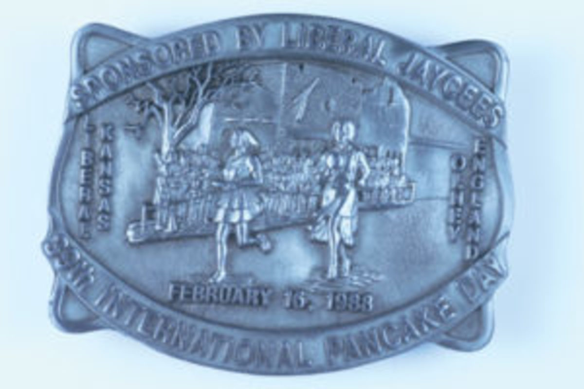 """1988 39th International Pancake Day buckle depicts the Pancake Day race held in both Liberal, Kansas and Olney, England on February 16, 1988. The back of the buckle shows it was designed by """"Western Associates Inc of Marion, Kansas."""" Limited Edition, No. 124 of 500. ($15, May 2017)"""