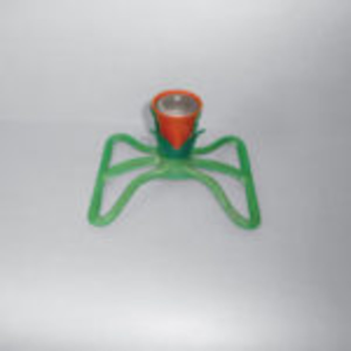 Small vintage flower shaped lawn sprinkler in red and green. $50-$60. From the author's collection.