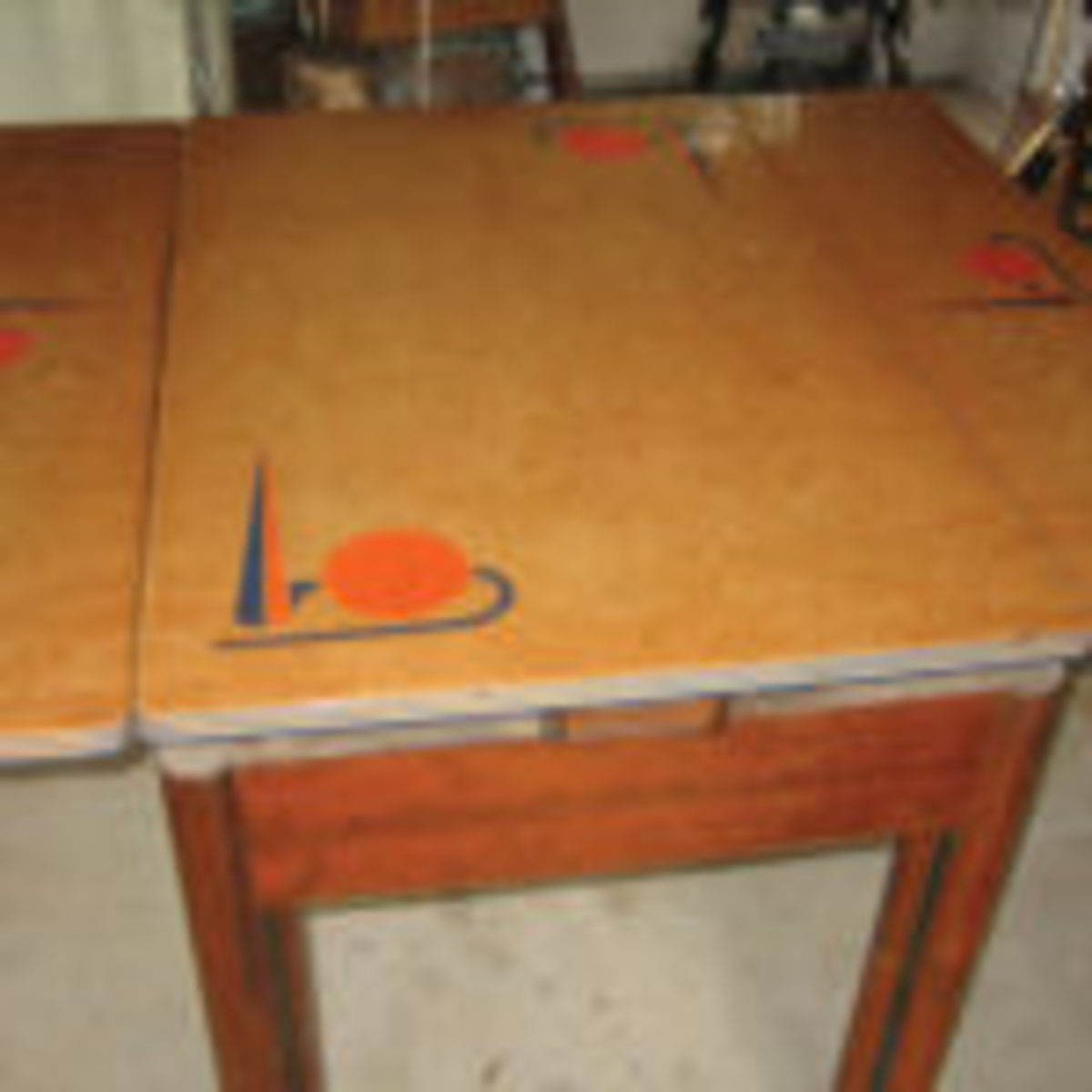 This Art Deco table shows a variation of the draw table, the side draw, with leaves on the side.