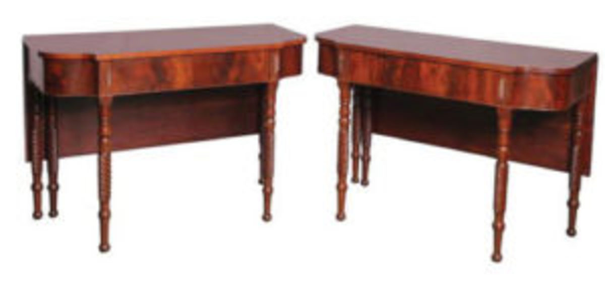 These Federal D end console tables have drop leaves attached that would rest on a rectangular center section.