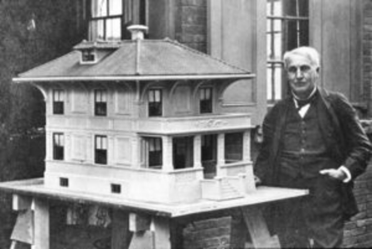 Thomas Edison with a Model of a Concrete House.