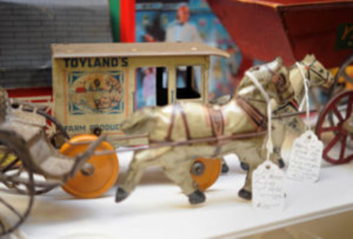 Tin toys sit on display in a booth at Scott Antique Markets in Washington Court House, Ohio. Photo courtesy Jess Grimm, Scott Antique Markets