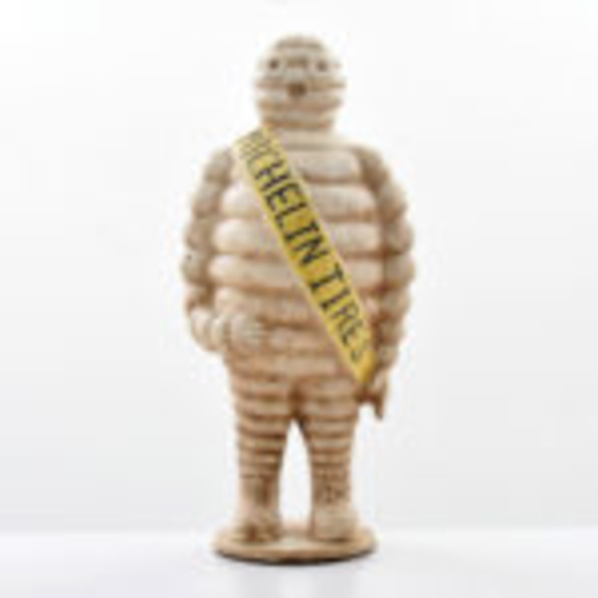 Cast-iron three-dimensional figure of Michelin Tires mascot 'Bibendum,' $2,080.