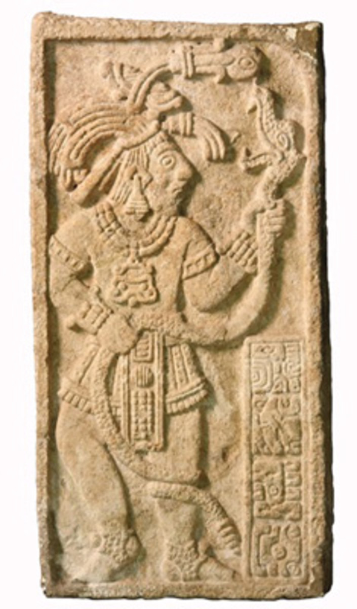 Mayan stone panel carved with the image of a priest bearing a serpent, originally found in Guatemala, $24,150.