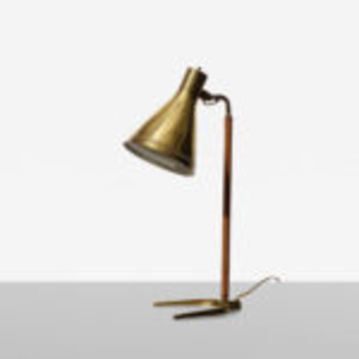 "Brass and leather table lamp, model 9224; signed, 8"" x 12"" x 21"", Paavo Tynell for Taito OY, Finland, 1950, realized $7,800. Courtesy Wright: Auctions of Art and Design, www.wright20.com"
