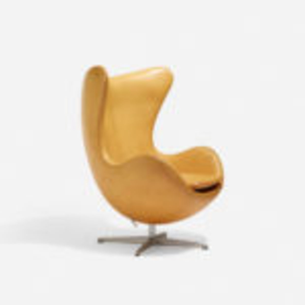 "Egg chair; leather, cast aluminum, plastic; Arne Jacobsen for Fritz Jansen, signed, documented, 34"" x 32"" x 41.5"", Denmark, 1958, realized $7,500. Courtesy Wright: Auctions of Art and Design, www.wright20.com"