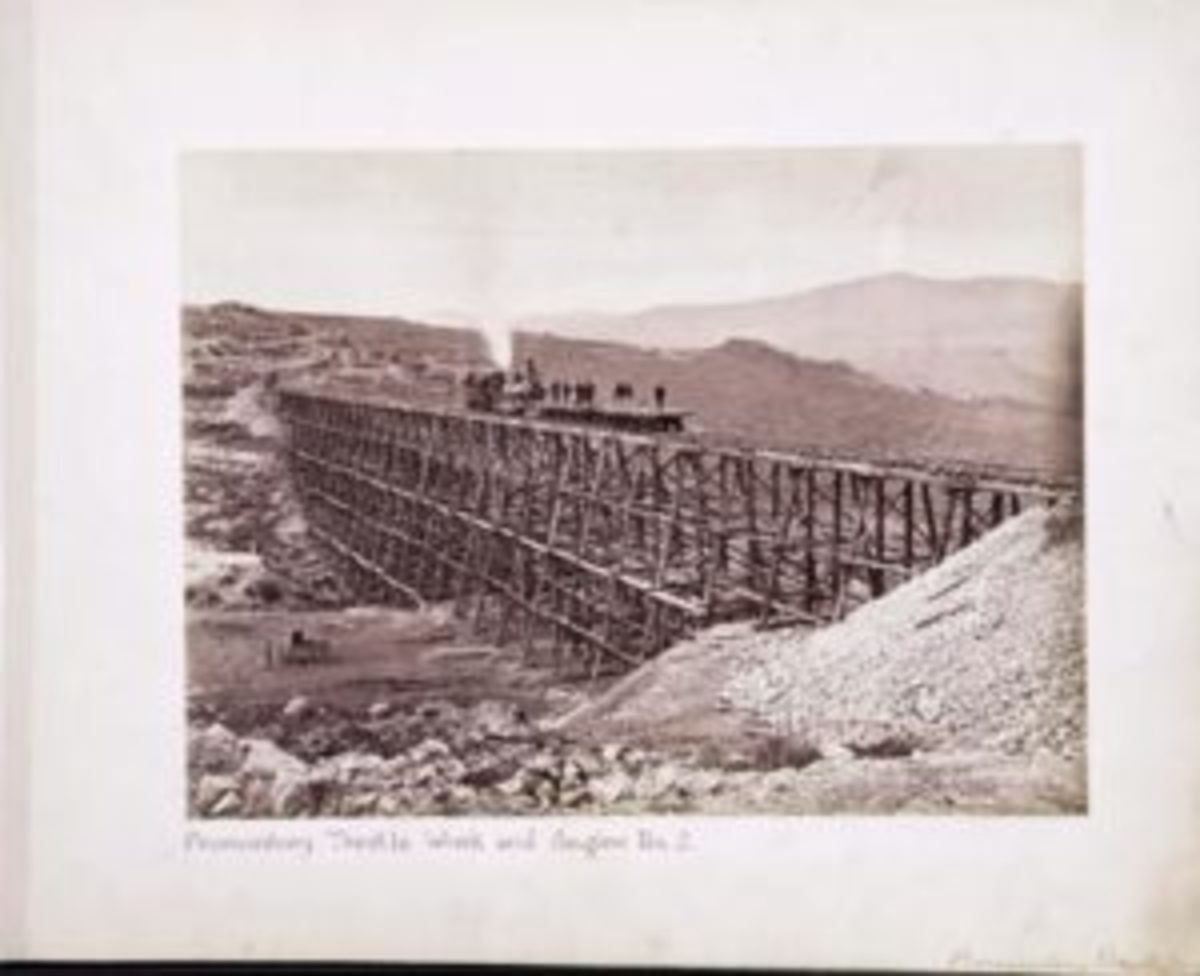 "Andrew J. Russell imperial print, ""Promontory Trestle Work and Engine No. 2,"" plate 222. The locomotive No. 119 is pictured on the trestle bridge and Andrew Russell's photography wagon is in the valley below."