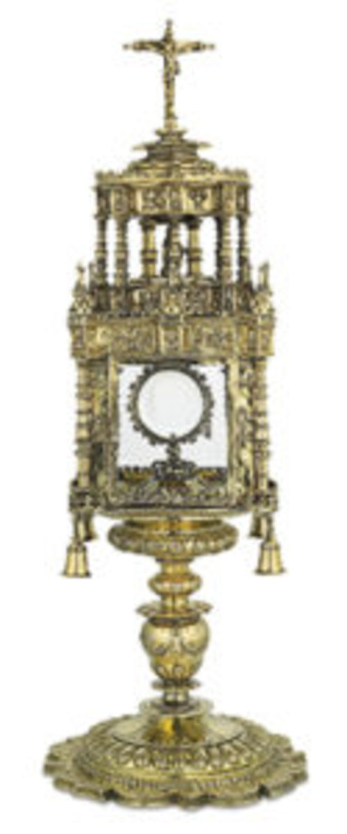 """Incredible Spanish, embossed, chased, silver-gilt monstrance, featuring rising octagonal temple enclosing the Mater Dolorosa below the crucified Christ, with four ceremonial bells, illegibly marked on the base and three panels, 8 3/4"""" square x 24 1/2"""" high, 5630 grams, ca. 1550. Courtesy rauantiques.com"""