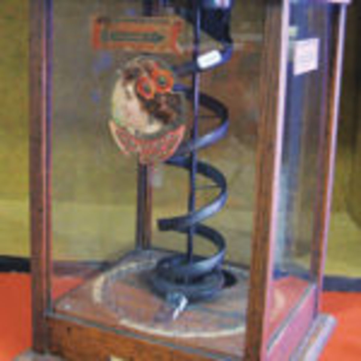 In the early 1900s you'd have a winner's choice of a cigar or stick of gum while playing the 20th Century Novelty Co., coin operated trade stimulator shown by Jack Freund, Springfield, Wisconsin. The 18-inch-tall gambling device was priced today at $2,100.