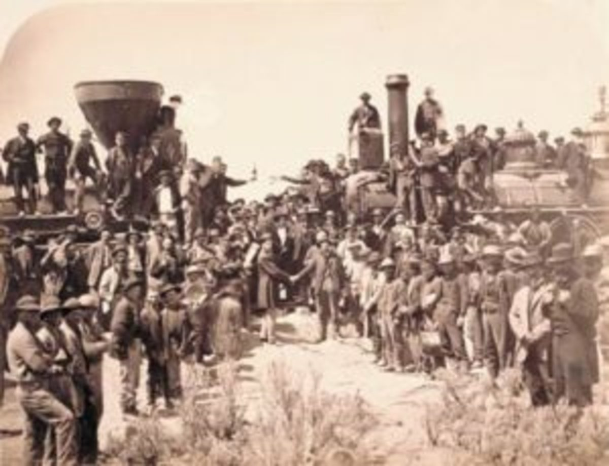 """East and West shaking hands at laying of the last rail,"" Promontory Summit, Utah. Photograph was taken by Andrew Russell on May 10, 1869. General Dodge, chief engineer for Union Pacific, is pictured shaking hands on the right, with Central Pacific engineer Montague on the left. This print was created before the original glass plate was broken. The glass plate negative is in the collection of the Oakland Museum (California). Photo courtesy Union Pacific Museum."