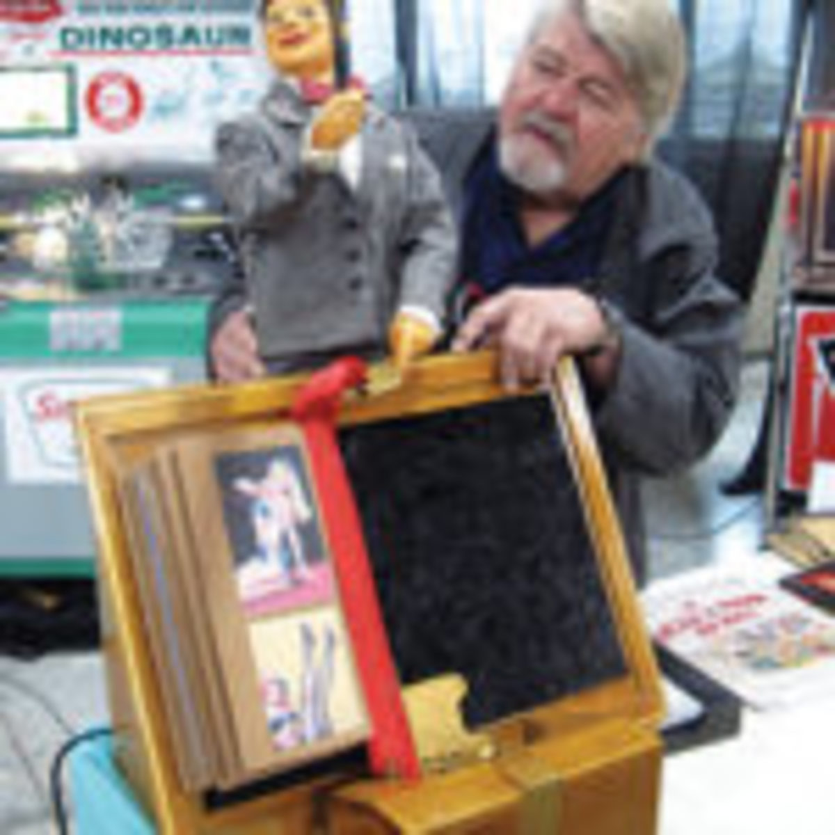 """Paul Pincott, an associate of Collector-Concierge-International, B.C. Canada, adjusts the 38-inch-tall animated """"window tapper"""" with 12 different movements. The 1920-30s advertising figure could perform at your place for $9,000."""