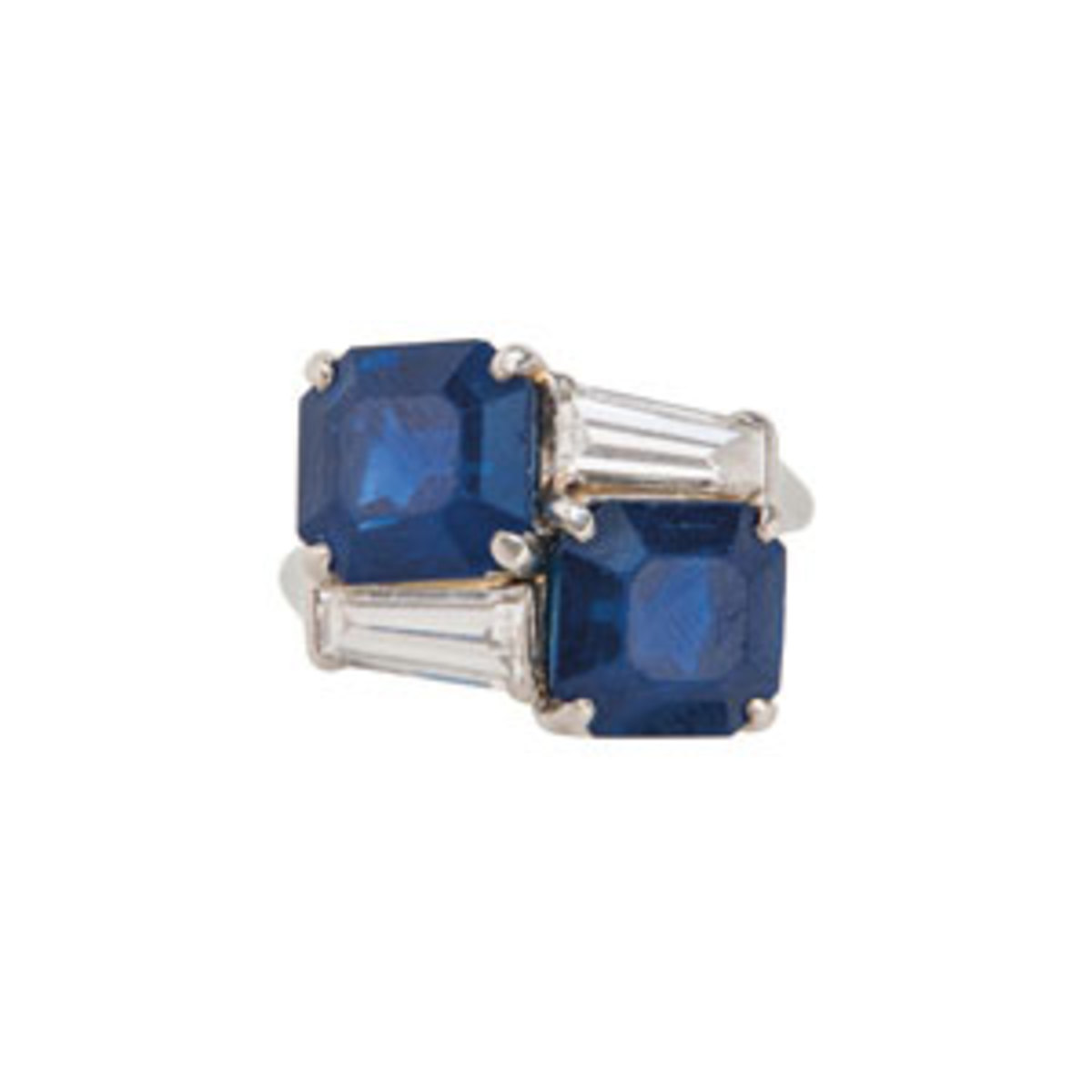 An important sapphire and diamond ring, Cartier,c. 1950s, set with two square-cut sapphires measuring approx. 9.21 x 8.64 x 6.55 and 9.27 x 8.75 x 6.05 mm, in a platinum and diamond mount set with tapered baguette-cut diamonds, size 5 3/4, numbered, signed.Estimate $300,000-$500,000.Images courtesy of Skinner Auctioneers and Appraisers