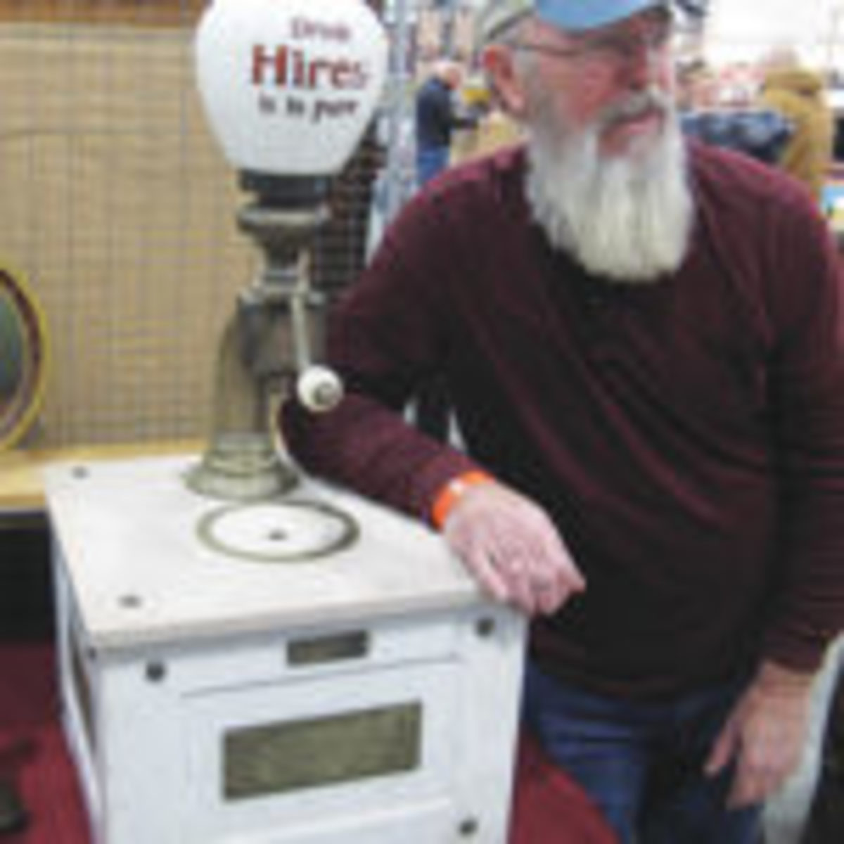 Dave Smith, Old 54 Antiques, Macks Creek, Missouri, uses his early 1900s Hires Root Beer Syrup dispenser as an arm rest. You could do the same if you like, for $5,200. All photos courtesy Jack Kelly