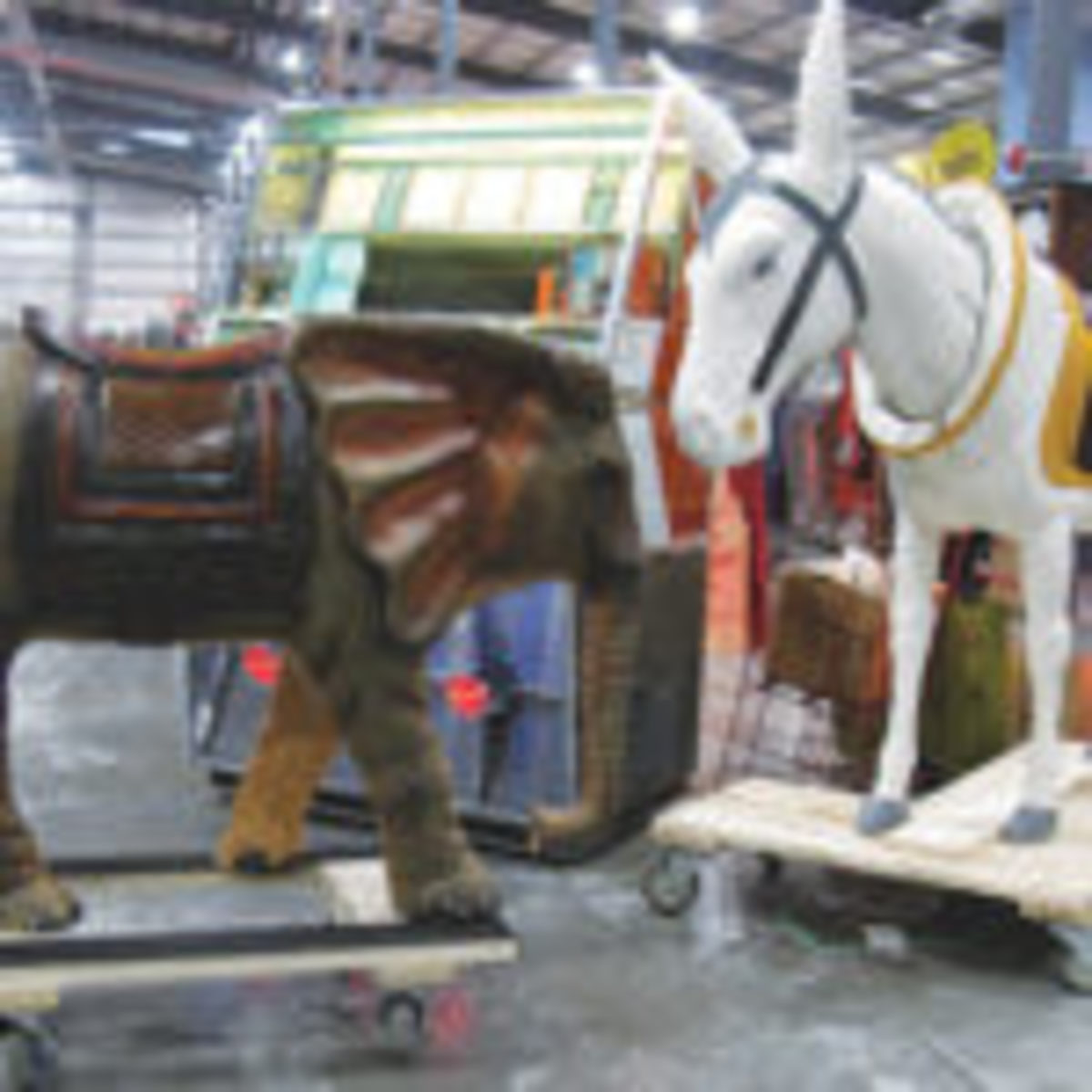 A full size hand carved wood baby elephant, priced at $850 appeared to be having a conversation with a full size carnival ride donkey, with bobbing head, priced at $3,995. The oddball pair was shown by Lee Godbey of Burton, Michigan.