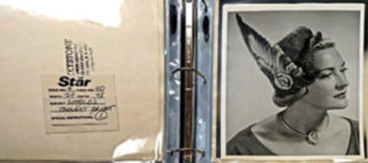 Binder with fashion model publicity photos. Nearly 100 binders will be auctioned.