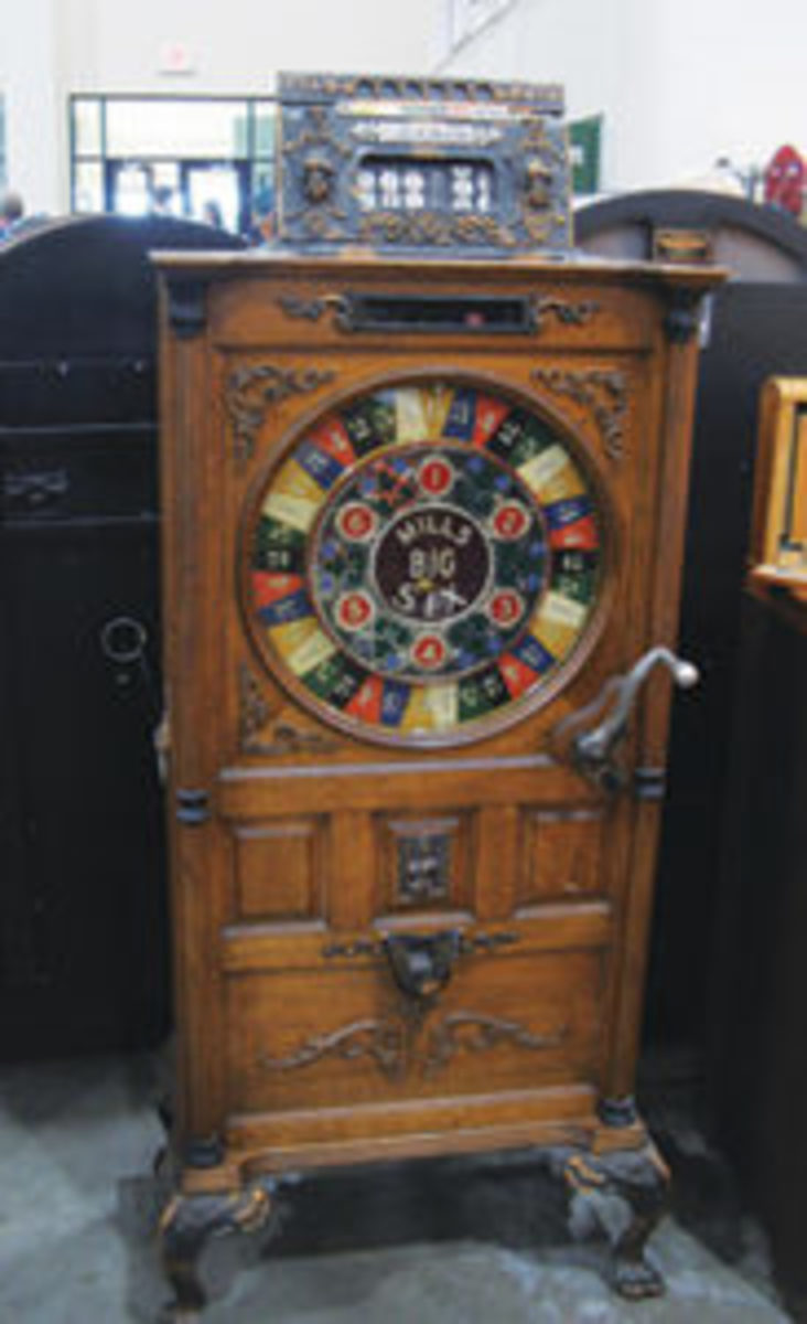 """We sold this one 30 years ago and got it back to sell again,"" said dealer Frank Zugmunt Jr., pointing to a 6-foot-tall wood and cast iron Mills Big 6 floor model slot machine. The Westmont, Illinois, dealer said this time around it was priced at $18,000. All photos courtesy Jack Kelly"