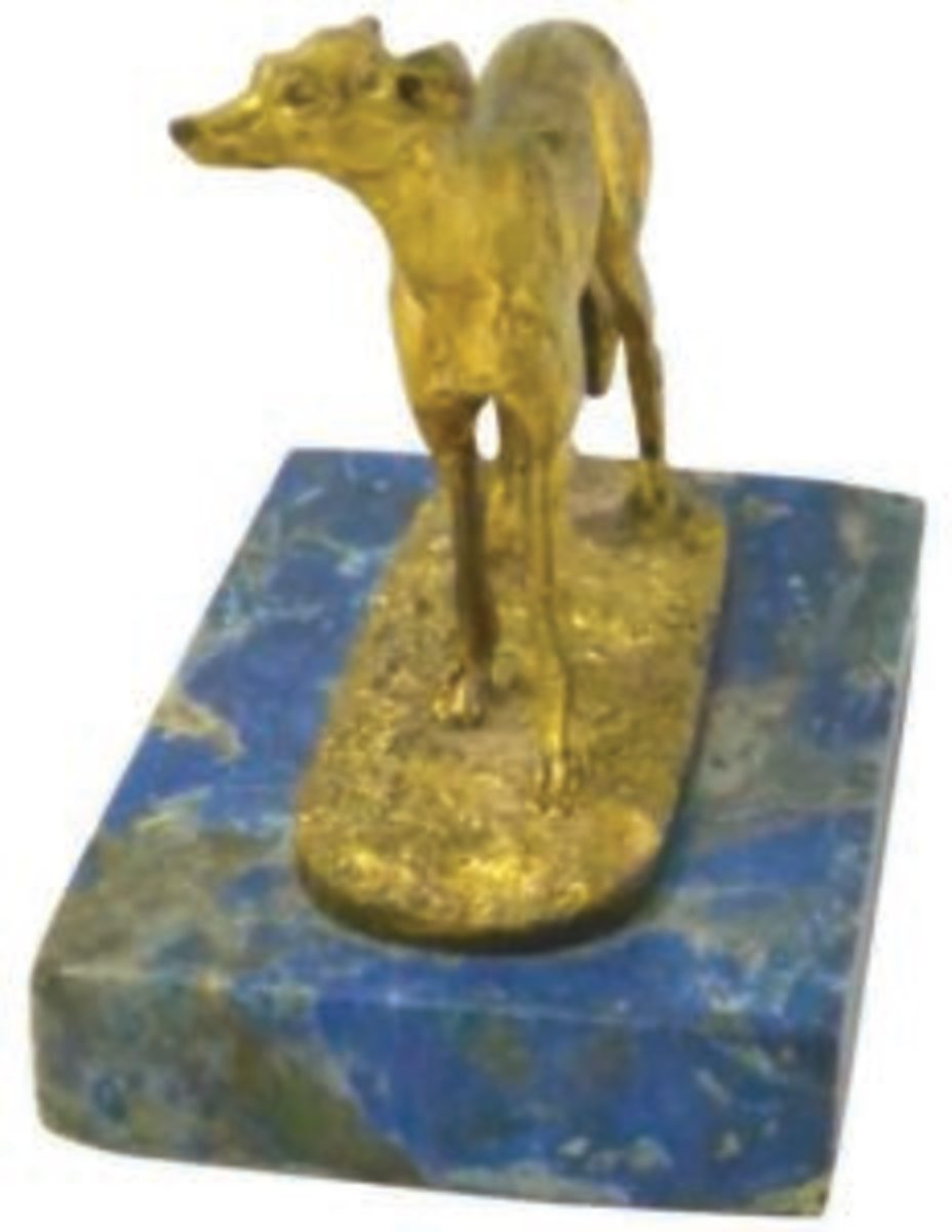 "This rare, miniature, gilded bronze sculpture of a Greyhound was sculpted by Pierre-Jules Mene (French, 1810-1879). It was known as ""Levrier Espagnol (Diego) Seul,"" and it is on its original lapis lazuli base. Image courtesy of A Dog's Tale Collectibles"