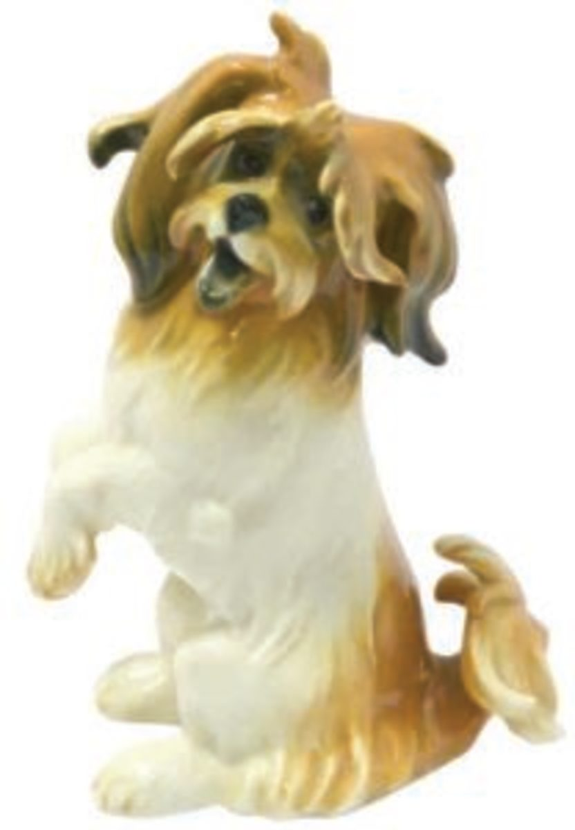 A sweet and joyful Lhasa Apso porcelain figurine. This rare vintage piece by Karl Ens, c. 1910-1920s, was manufactured by the Volkstedt Porcelain factory of Germany prior to World War II.Image courtesy of A Dog's Tale Collectibles