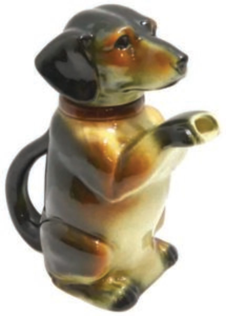 "If you collect teapots, or love Dachshunds, this piece will brighten your mornings. The Majolica ""Erphila"" figural teapot, c.1938-1945, sits upright at a full 8"" h x 7"" l x 3 3/4"" w and is just waiting to serve you. Image courtesy of A Dog's Tale Collectibles"
