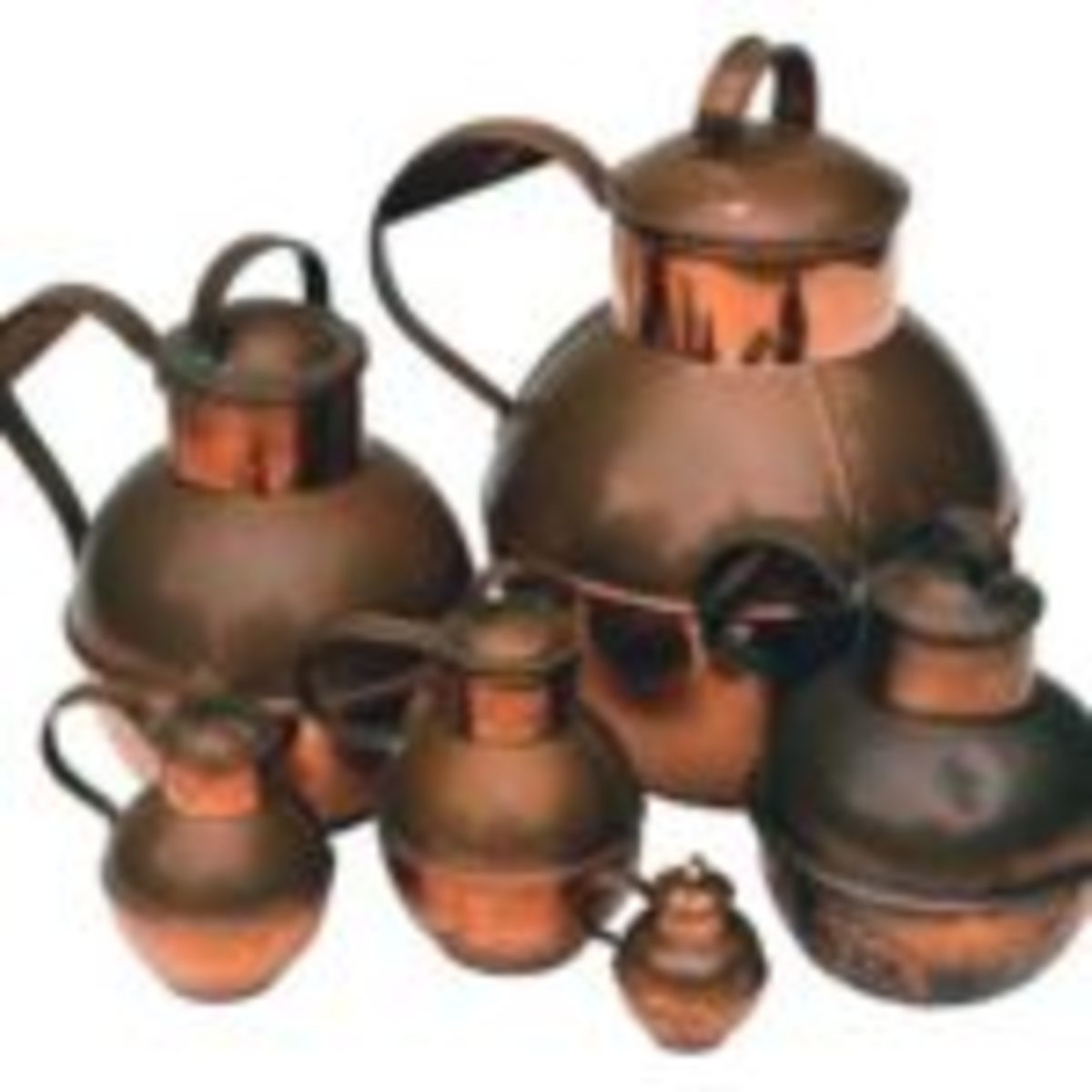 Guernsey milk pots. Guernsey is one of the Channel Islands just off the northern coast of France. These containers have been made in this same design for over 1,000 years. The examples here range in volume from one gallon to an eighthof a pint.