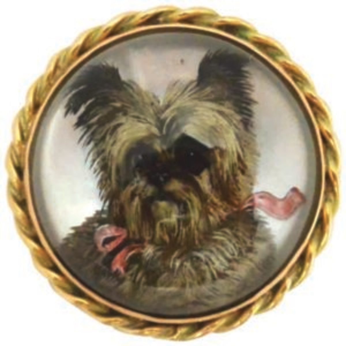"It is hard to resist such an affectionate portrait of a furry friend. This c.1890 Essex Crystal brooch captures in three-dimensional perfection a sweet Cairn Terrier sporting a flouncy pink ribbon collar and bow. At 1-1/4"" in diameter, this hand-painted in reverse intaglio crystal is mounted in 18k gold and is elegantly framed in a braided gold border. The background is mother of pearl. Image courtesy of A Dog's Tale Collectibles"