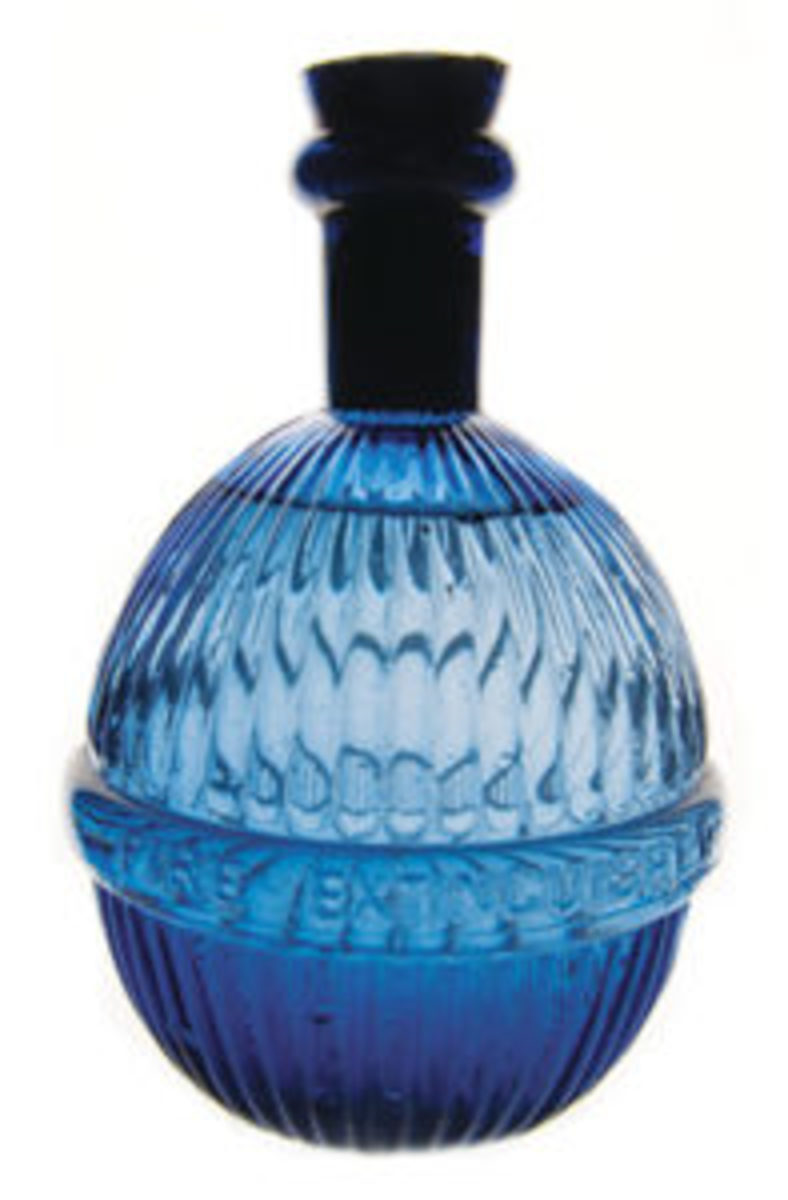 A beautiful vertical ribbed fire grenade in blue glass.