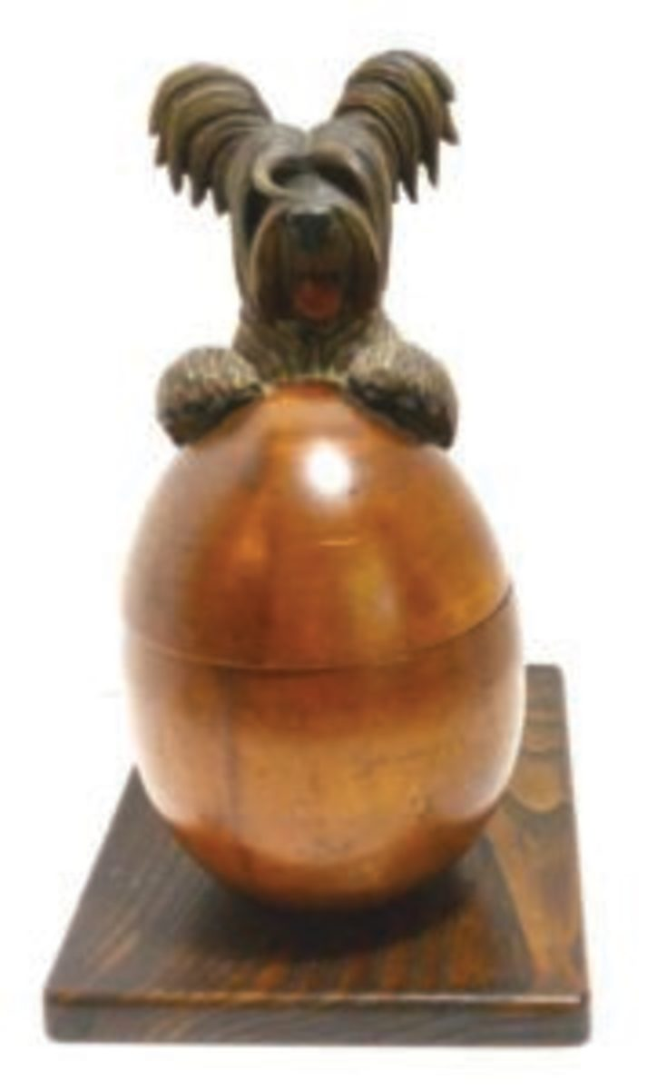 This adorable hand-carved Anri Skye Terrier is a humidor. The humidor is an egg-shaped box that opens as you push on the dog's tail. The Skye Terrier has been a hallmark design of Anri, and this is one of its most popular and sought-after pieces. Image courtesy of A Dog's Tale Collectibles