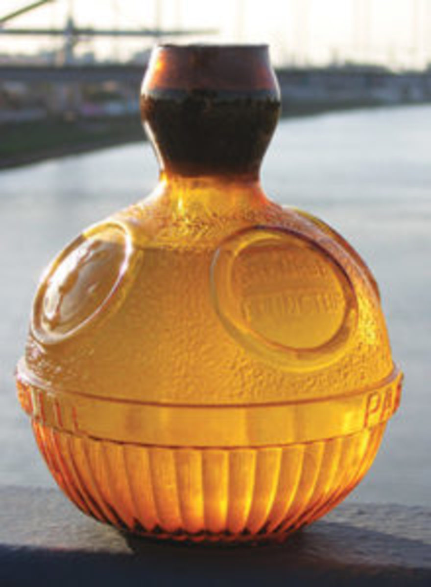 "This 6"" tall amber fire grenade was manufactured in France. It is sealed and still contains salt water inside. Has four embossed circles. Offered by mallaubzustaub605, eBay seller from Germany."