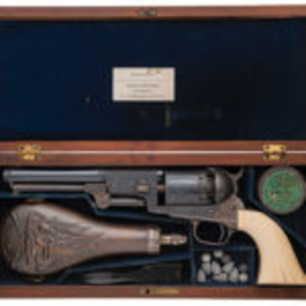 "Well-documented Gustave Young master engraved cased Colt Third Model Dragoon Percussion Revolver known as ""The Millikin Dragoon."""