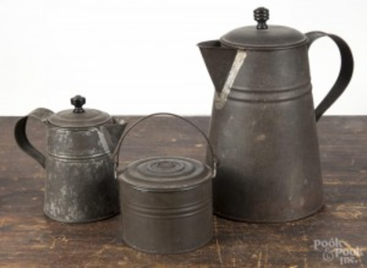 Three pieces of early American tin, 19th c. to include a coffeepot, 8 3/4'' h., a cream pitcher, 5 1/4'' h., and a small berry pail, 3'' h., carry a presale estimate of $60 to $80 into the sale. (Photo courtesy Pook & Pook)