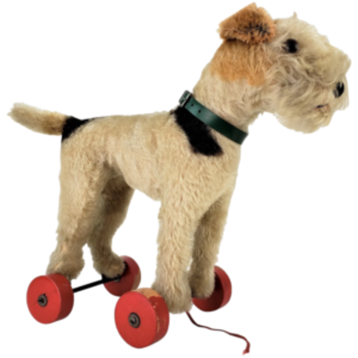 Steiff also made pull toys that are now highly collectible, such as this plush little dog pull toy, circa 1950; $395. Courtesy of Frederickpine: rubylane.com/shop/frederickpine