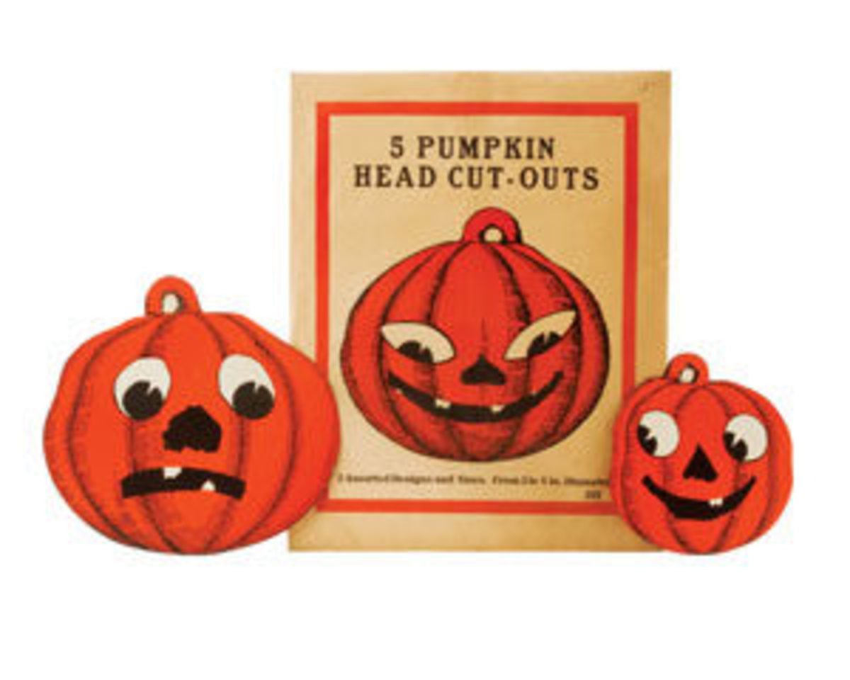 "Enveloped set of five pumpkin head cut-outs, U.S.A., Beistle, no mark, early 1920s, envelope 12-1/4"" h x 9-1/2"" w, contents 5"" to 8"" dia; $400."