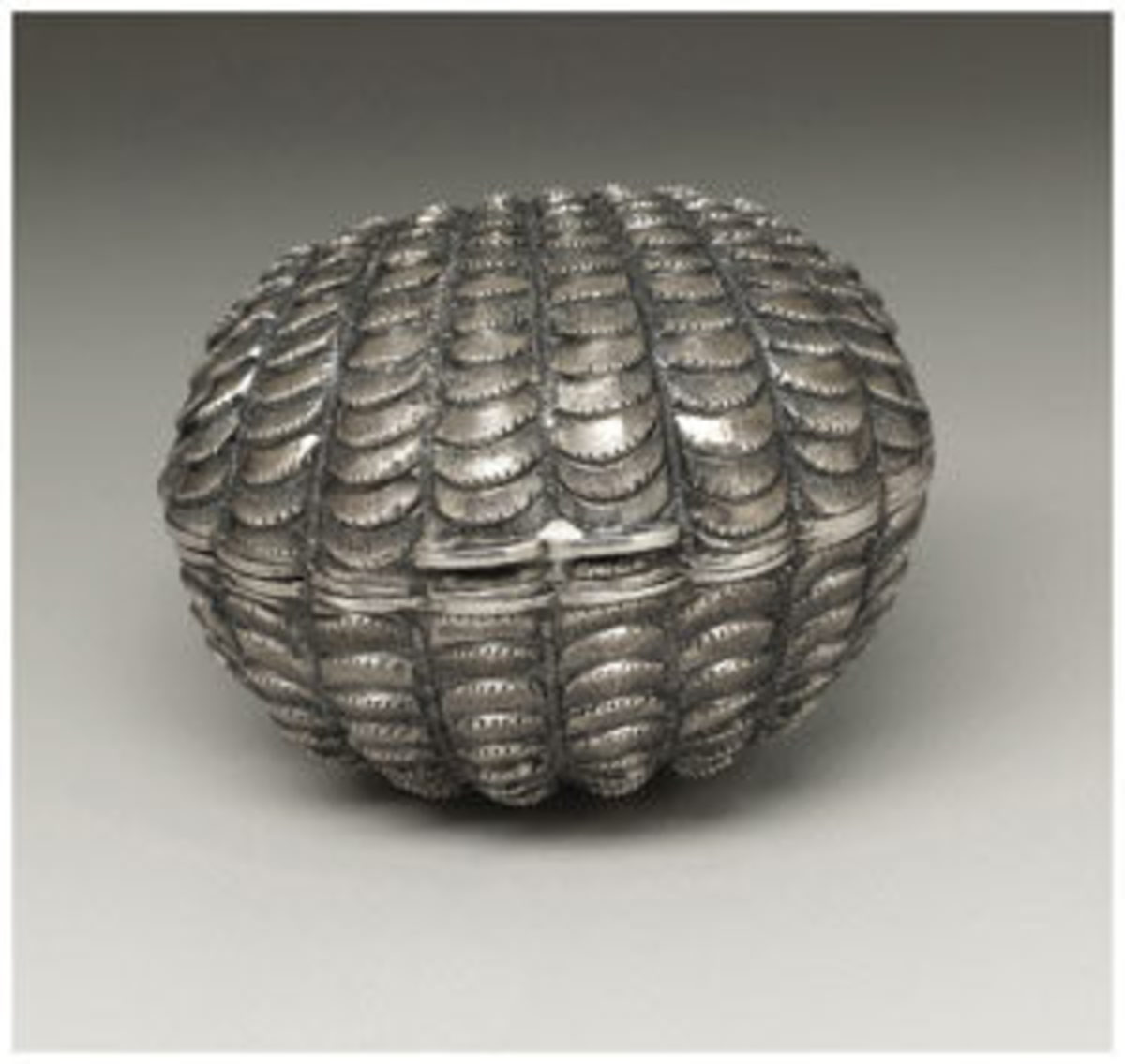 "A Victorian silver and steel nutmeg grater, Hilliard & Thomason, Birmingham, England, 1865-66, of a scalloped cockle shell form with hinged steel grater, 1.62"" l, $2,390. Courtesy of Heritage Auctions"