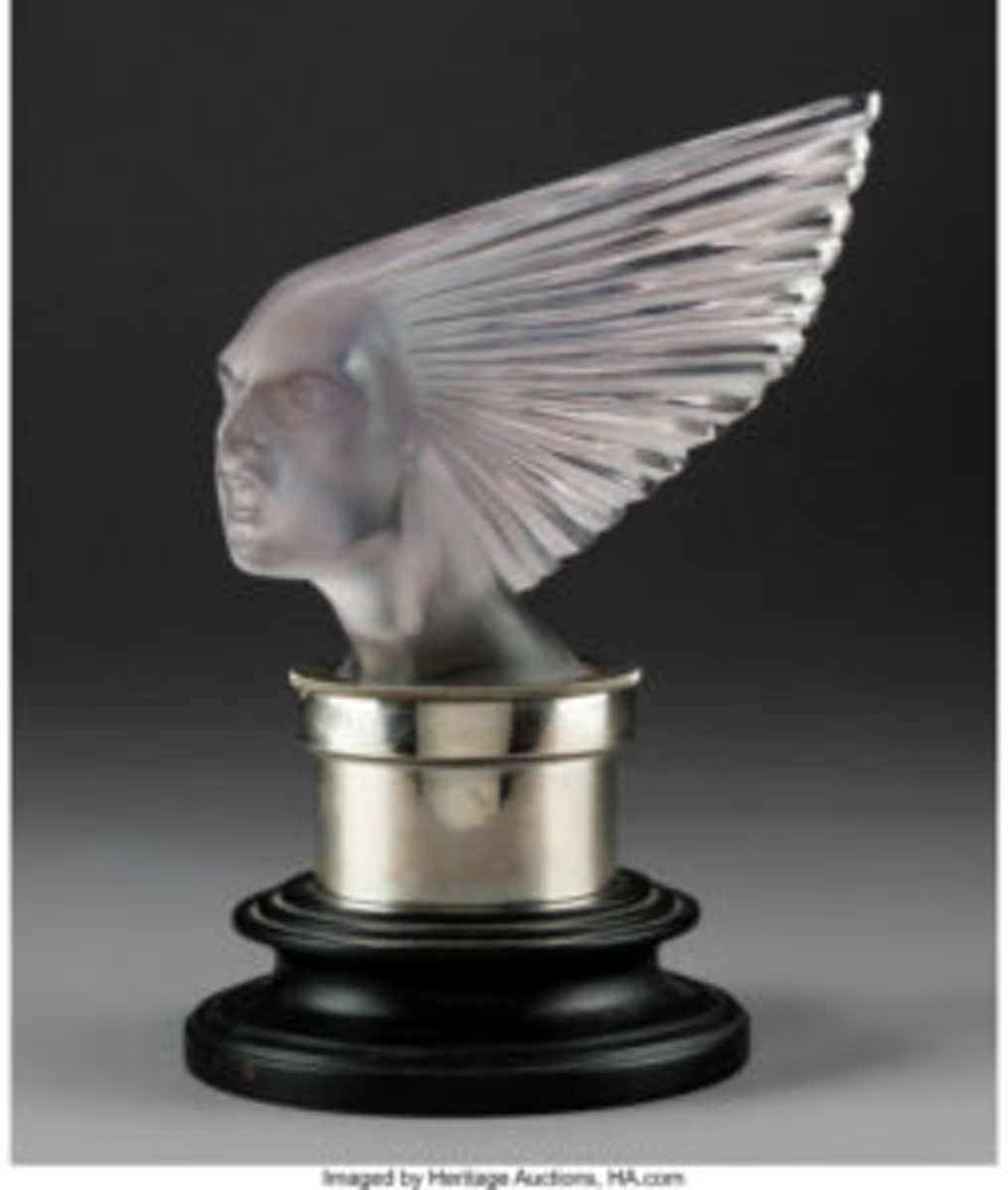"R. Lalique Victoire clear and frosted amethyst glass automobile mascot, circa 1928, marks: R. LALIQUE, FRANCE, 10-3/8"" excluding base, $10,000."