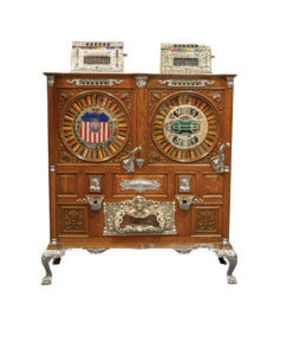 "This rare and magnificently preserved Mills Double Dewey slot machine was manufactured by The Mills Novelty Co. of Chicago, circa 1898. This early upright slot machine is the forerunner of all the tabletop machines that followed and made Chicago the ""Slot Machine Capitol of the World."" One side operates with nickels, while its twin takes quarters only; a rather hefty fee for the early 1900s; estimate: $60,000-$70,000"