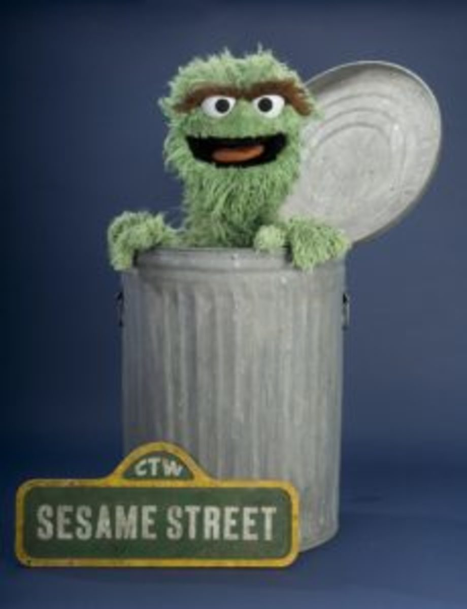 "Despite his grouchiness, Oscar the Grouch is a valued friend to the other characters on ""Sesame Street"" and demonstrates the importance of understanding, tolerance, and diversity. In the first episodes of the show, Oscar was orange, but by 1970, he became green. Oscar explained that this change was due to his vacation at Swamp Mushy Muddy, where it was so damp that he became covered in slime and mold.Image courtesy of the National Museum of American History"