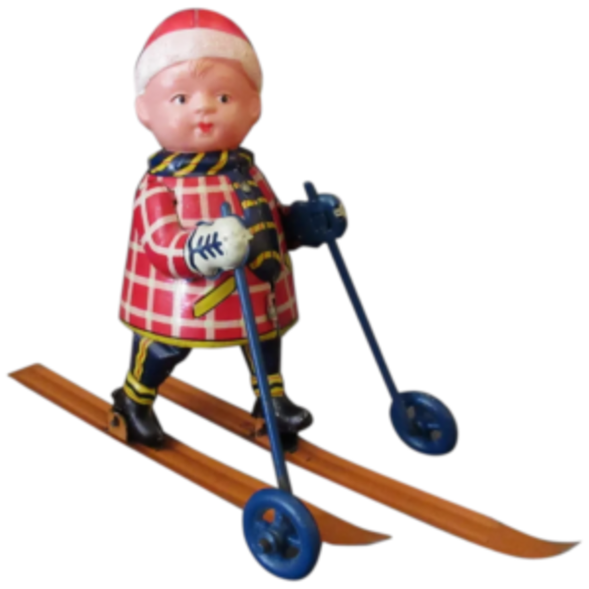A fun antique celluloid and tin Occupied Japan wind-up toy of a young cross country skier. The mechanism is housed in the body and when it is wound by the attached key, the skier's legs move back and forth moving the skis in a realistic motion. The arms are stationary but there are wheel on the ski poles to facilitate movement; $295. Courtesy of Ogee's Antiques: rubylane.com/shop/ogees