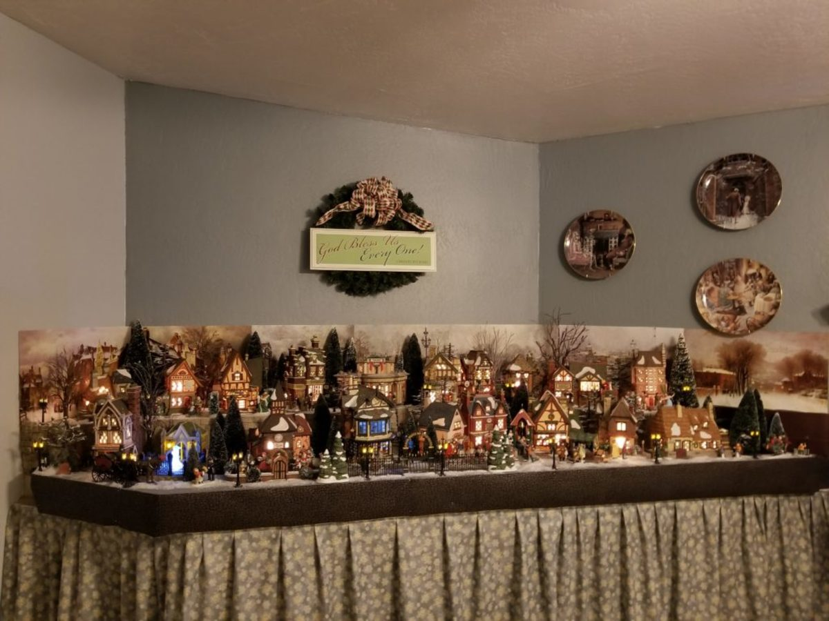 Sue Chretien's Christmas Carol display that she keeps up all year long. The plates on the right side of the display are also by Dept. 56. Image courtesy of Sue Chretien